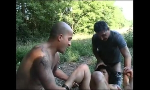 A dark brown caught alone in the country is group-fucked by strangers