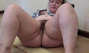 A chunky unshaded close by a soft vagina masturbates close by a cucumber