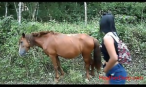 peeing next to horse in jungle